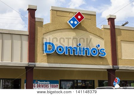 Muncie IN - Circa July 2016: Domino's Pizza Carryout Restaurant. Domino's is 97% franchise-owned with 840 independent franchise owners II