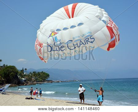 PUERTO VALLARTA MEXICO MAY 11 2016: Parasailing is one of the most thrilling and popular beach activities in Puerto Vallarta.