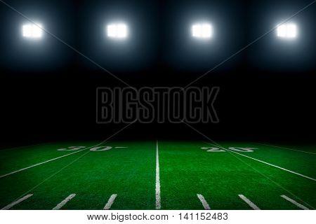 American football field with stadium lights background