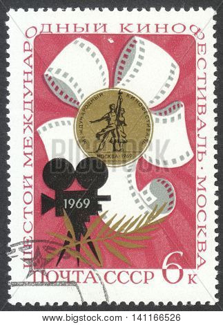 MOSCOW RUSSIA - CIRCA APRIL 2016: a post stamp printed in the USSR dedicated to the 6th International Cinema Festival circa 1969