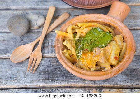 Thai food curry streaky pork with bamboo shoots in earthenware