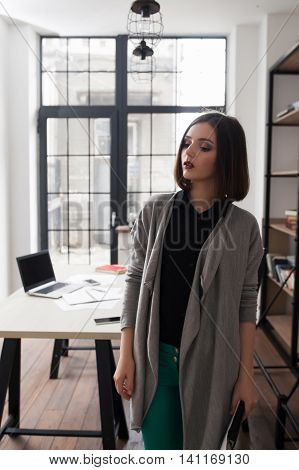 Attractive business woman, standing in office. City life, occupation, modernization concept