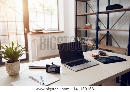 Freelancer desktop with necessary work tools. Startup retoucher and photographer office. Modern technologies, remote working, home employment concept