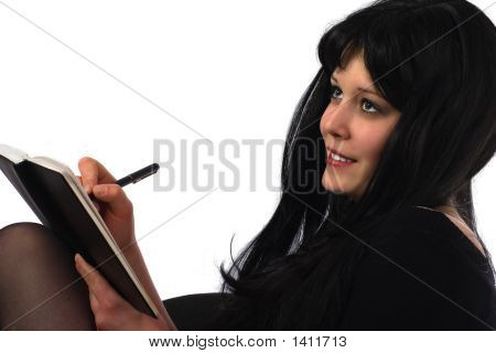 Businesswoman Writing In Organizer