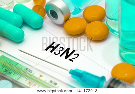 h3n2 (influenza grippe). Treatment and prevention of disease. Syringe and vaccine. Medical concept. Selective focus