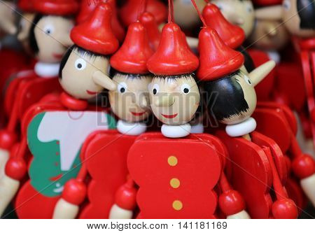 Painted wooden marionette dolls of the figure of Pinocchio
