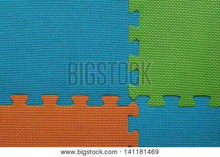 blue orange and green interlocking foam playroom floor mats