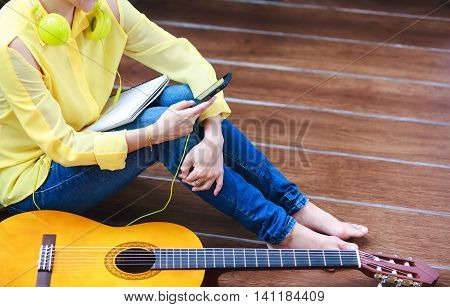 Closeup Woman Music Lover Using A Phone For Entertainment.
