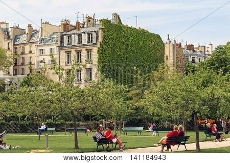 PARIS, FRANCE - MAY 12, 2015: This is garden Catherine-Laboure which was closed in the past the church garden and in the present time is open to the public.
