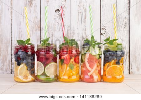 Refreshing infused water summer drinks with fruits and mint