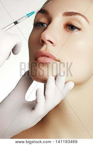 Portrait Of Young  Woman Getting Cosmetic Injection. Closeup Of