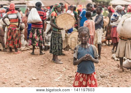 FASHA ETHIOPIA - August 15 2015: unidentified people from Konso tribe take part at the weekly market in Fasha. Konso women dress typical skirt with multicolored stripes