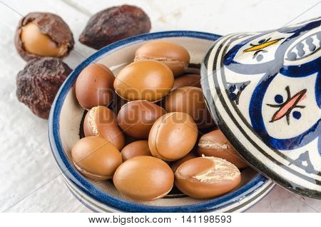 Argan Fruit on a wooden tabletop in a Moroccan Tajine