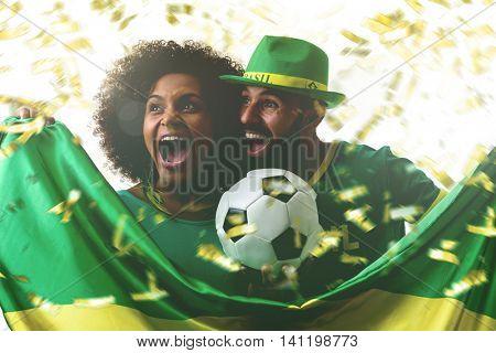 Brazilian couple fan celebrating