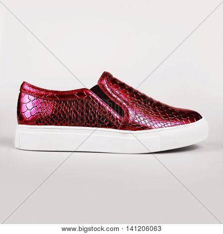 pair of new red shoes in grey background
