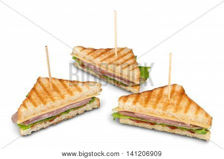 Freshly made club sandwiches served on a wooden chopping board