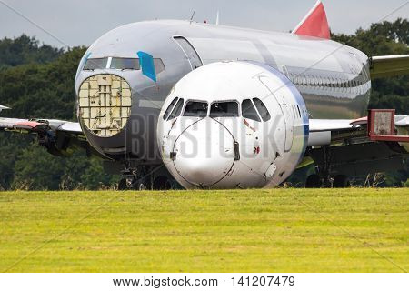 Close up of two redundant passenger airliners being dismantled in a field