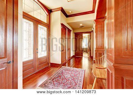 Bright Foyer In Luxury Home With Hardwood Floor.