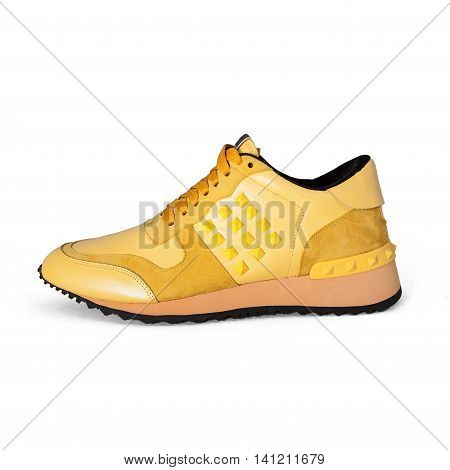 summer stylish yellow sneakers on white background