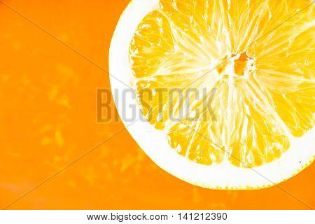 Slice of orange in the orange background