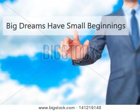 Big Dreams Have Small Beginnings - Businessman Pressing Virtual Button