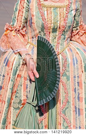 Lady With An Ancient Ceremonial Dress And The Fan