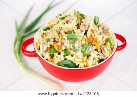 Fragrant Pilau Pulav pilaf pilaf, fried rice with meat and vegetables on a grey plate. Isolated on white. Macro.