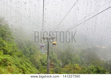 water drop foreground with cable car scene in the background genting Malaysia
