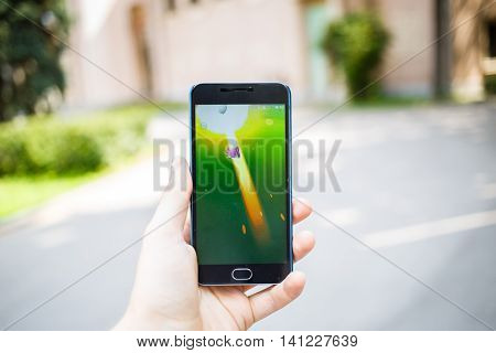 Moscow, Russia - August, 02: Android user play in Pokemon Go augmented reality mobile game on smartphone.