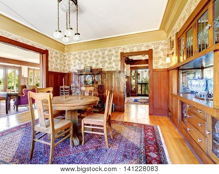 Open Floor Plan Antique Dining Area With Wooden Pannel Trim