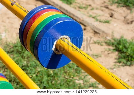 Shabby swing pipe with moving rings of red yellow green and blue color