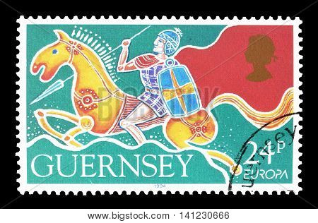 GUERNSEY - CIRCA 1994 : Cancelled postage stamp printed by Guernsey, that shows Warrior on horseback.