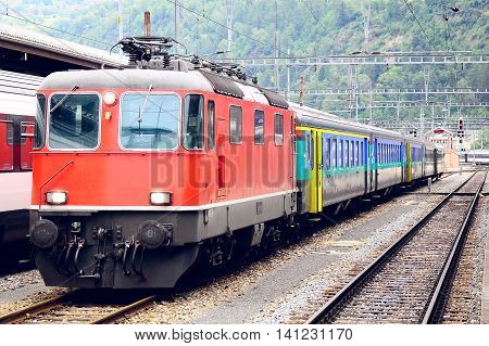Passenger train approach to the platform. Brig. Switzerland.
