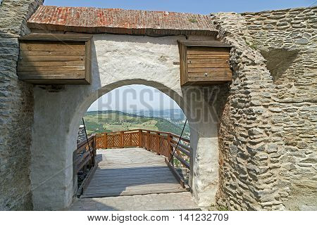 View of superior entrance at the citadel ruins of Deva (Transylvania Romania). Built in 1250 is located at a height of 371 meters above the city.