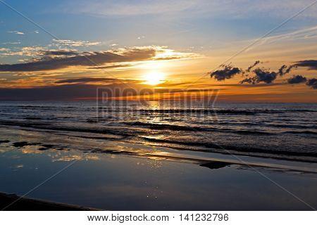 Beautiful Sunset Over Baltic Sea with cloud and beams, Jurmala Dzintari.