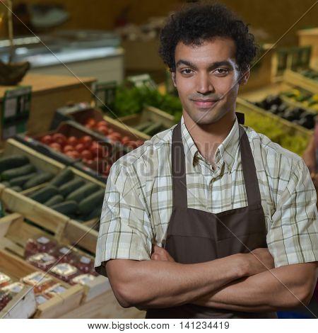 Portrait Of Grocery Clerk Working In Supermarket Store