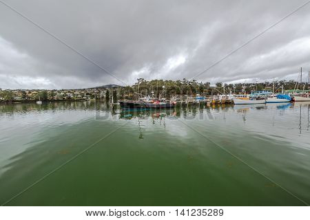 Panorama of the fishing boats, port of St Helens, Georges Bay, Tasmania, Australia. St Helens is the most important city of the northeast coast and is famous for the Bay of Fires