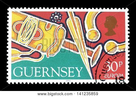 GUERNSEY - CIRCA 1994 : Cancelled postage stamp printed by Guernsey, that shows Sword, scabbard and spear.