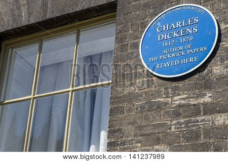 A blue plaque at The Angel Hotel in Bury St. Edmunds marking the location where Charles Dickens stayed while giving readings in the nearby Athenaeum.