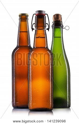 Set of beer bottles with drops isolated on white background.