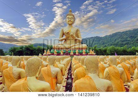Buddha statue with sky and mountain at Buddha Maka Bucha park temple Nakohn Nayok Thailand