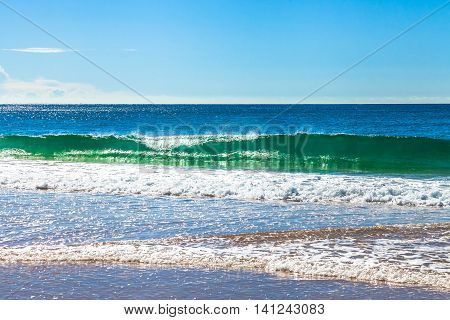 High waves in the famous Garie Beach in a summer sunny day, Royal National Park coastline, New South Wales, Sydney, Australia.