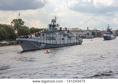 St. Petersburg, Russia - 31 July, Two warships opposite the Admiralty Embankment, 31 July, 2016. Festive parade of warships on the Neva River in St. Petersburg.