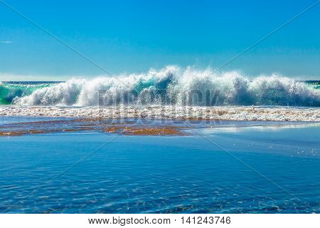 Strong currents and waves in the famous Garie Beach in a summer sunny day, Royal National Park coastline, New South Wales, Sydney, Australia.