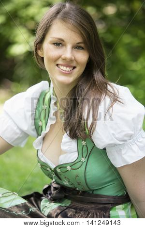 portrait of beautiful young woman wearing a bavarian dirndl