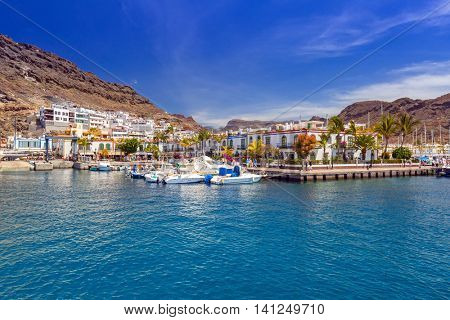 PUERTO DE MOGAN, GRAN CANARIA, SPAIN - APRIL 21, 2016: Marina of Puerto de Mogan, a small fishing port on Gran Canaria, Spain. Puerto de Mogan is called a Little Venice of the Canaries.