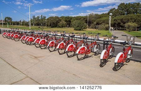 BARCELONA SPAIN - JULY 13 2016: Bicycles on a street of Barcelona. Bicing is the name of a bicycle sharing system in Barcelona inaugurated on March 22 2007.