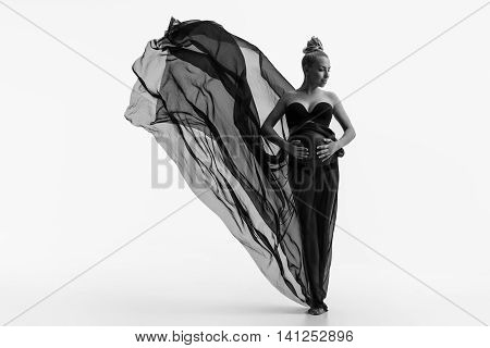 Beautiful woman face close up studio on white background with flowing fabric