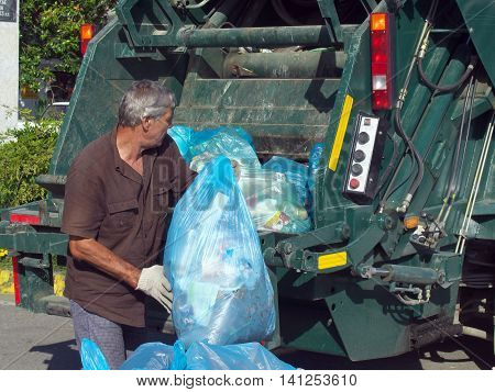 Lazarevskoe, Sochi, Russia - June 27, 2014: Garbage collection in the city streets Lazarevskoye