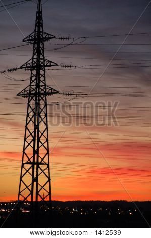 Power Pole And Cables On Orange Cloudy Sky